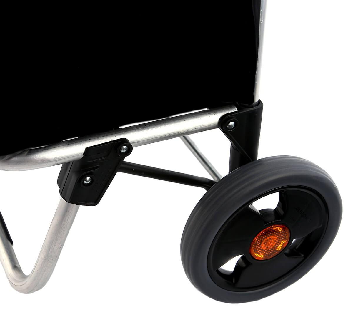 Kółka wózka na zakupy Aurora City London z widocznymi odblaskami